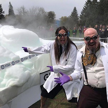 1.	burnaby orbax and pepper klopeck pose next to their elephant's toothpaste